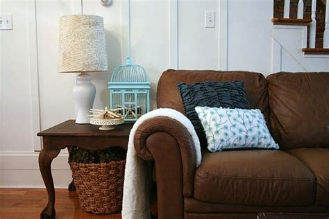 brown sofa with blue pillows change a room s look with throw pillows home stories a to z