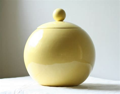 large vintage round yellow ceramic cookie jar by modishvintage