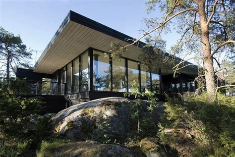Elemen Teko Stenles Elemen Pemanas Air Stenles modern wooden vacation house built on rocks