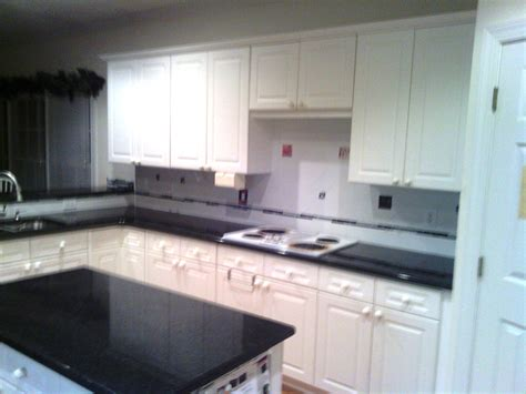 wonderful countertops for white kitchen cabinets this black pearl granite charlotte granite colors