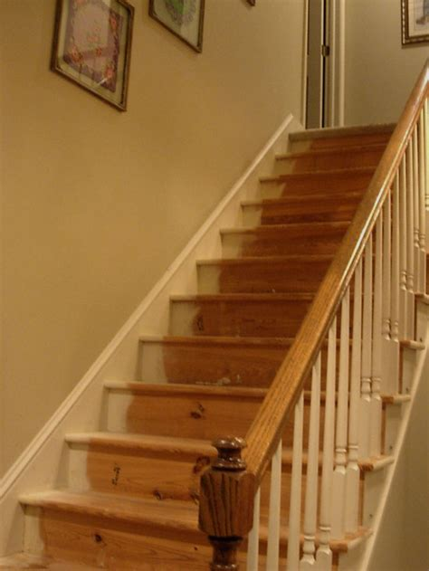 restaining banister replacing carpet on stairs with wood