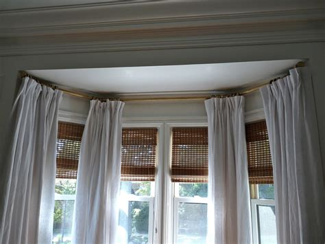 how to put curtains on bay windows ideas for hanging curtains in a bay window curtain