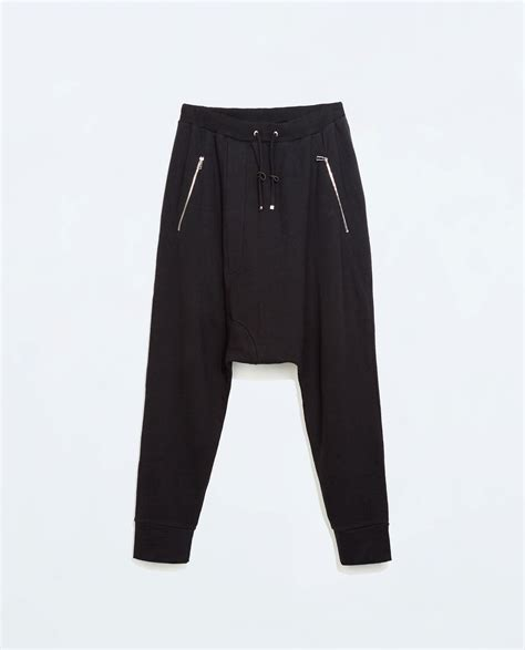 zara trousers with zips in zara baggy trousers with zips in black for lyst