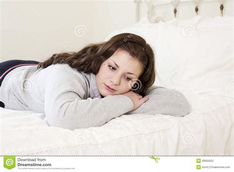 lying on the bed depressed girl lying on bed stock photography image