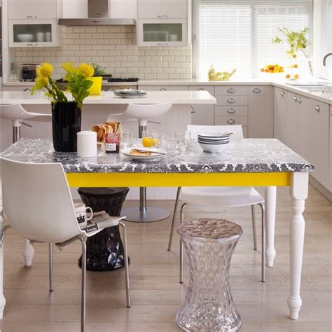 monochrome kitchen diner with yellow accents black and