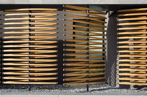 Room Divider Photo - house features wall of operable reclaimed douglas fir screens