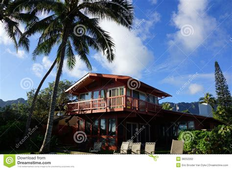 how tall is a 2 story house red two story beach house with tall coconut trees stock photography image 38252202