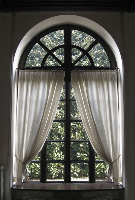 arched curtain rod for windows 25 best ideas about arched window curtains on pinterest
