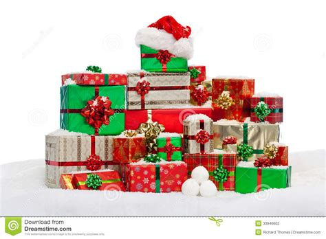 photo presents stack of gift wrapped christmas presents on snow stock