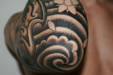 japanese elbow tattoo designs swirl on gap filler inside bicep
