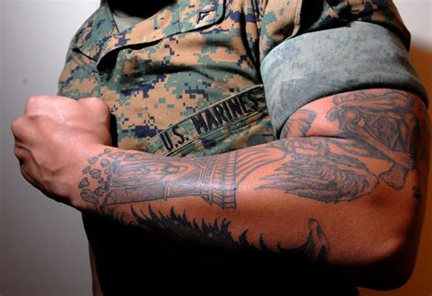 marine corp tattoo policy combat vets say policy is big barrier to re enlistment