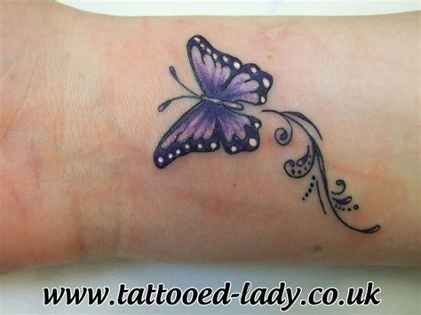 small purple butterfly tattoo best 25 butterfly tattoos on wrist ideas on