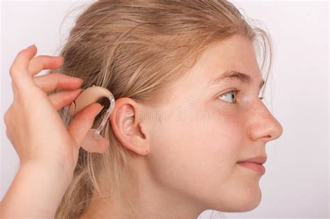 wraring hearing aid washed hair girl insertin hearing aid into ear stock photo image of