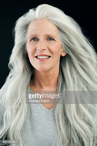 hair styles blown by the wind mature woman with wind blown long gray hair stock photo