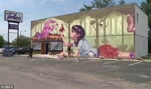 Cat Wall Murals outrage as artists paint mural of woman feeding beaver on