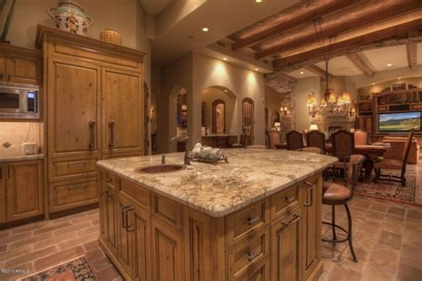 italian kitchen decorating ideas with terra cotta floor and wooden kitchen island using textured