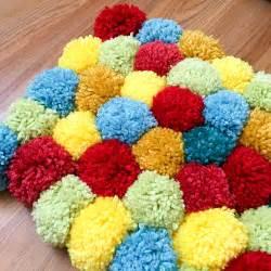 pompom rugs tessa s favorite colors aqua yellow and green pom pom rug we r memory keepers