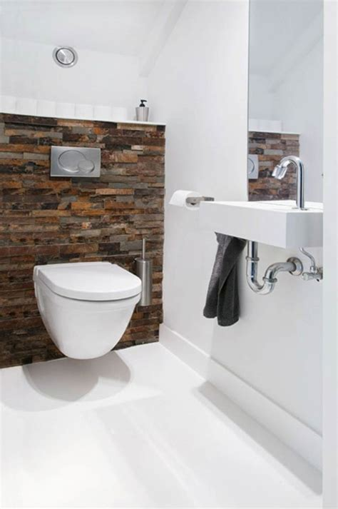 modern washroom hout en betonstuc in toilet interieur inrichting