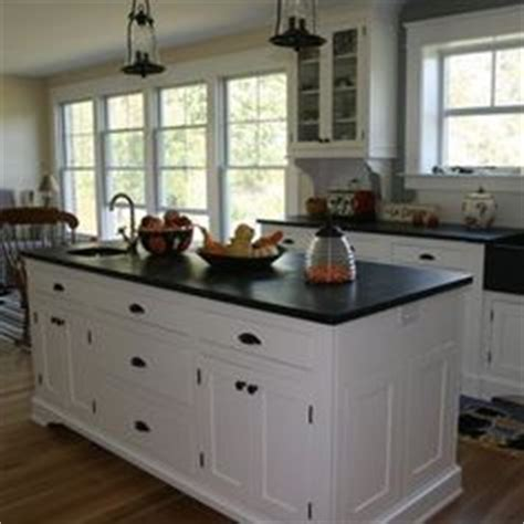 white kitchen cabinets with black hardware on