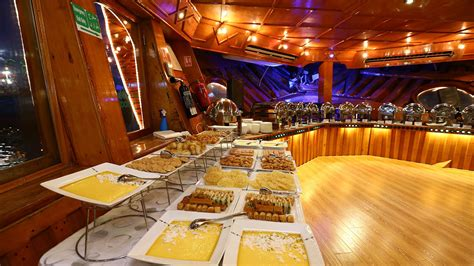 dinner on a boat abu dhabi abu dhabi dhow cruise dinner daily sharing boat
