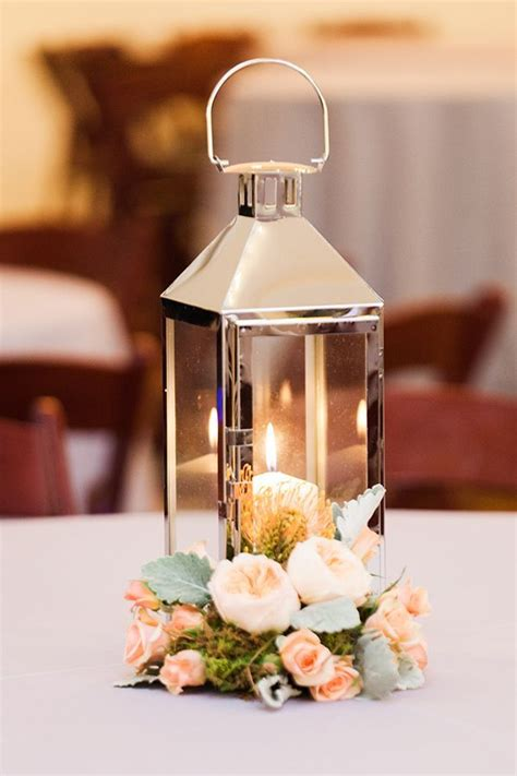 silver lanterns for wedding centerpieces 25 best ideas about silver lanterns on beige candle holders silver pendant lights