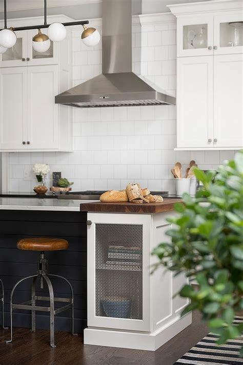 black shiplap island  industrial stools transitional kitchen