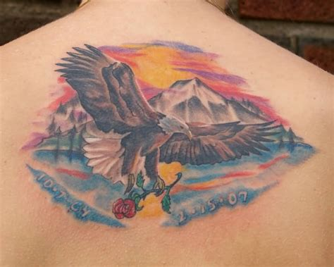 eagle rose tattoo eagle flying with in claws memorial on back