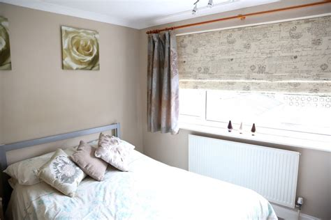 How mary layered roman blinds and curtains in her bedroom web blinds