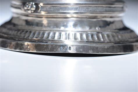 candelieri argento coppia di candelieri in argento sbalzato e cesellato