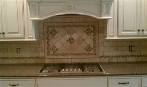 glass and travertine backsplash