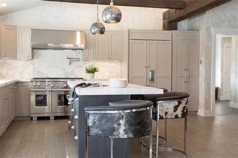 dark grey island with white countertop and antique white white kitchen island with thick marble countertop and gray