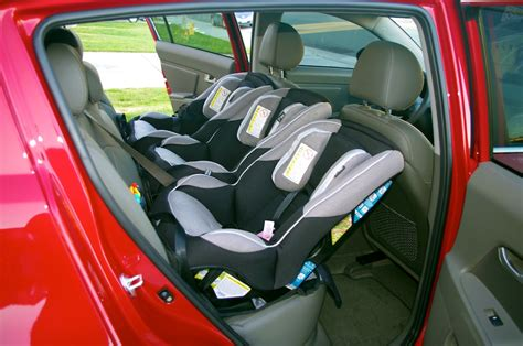 cars with three rows of seats 3 car seats in one row spontaneous triplets