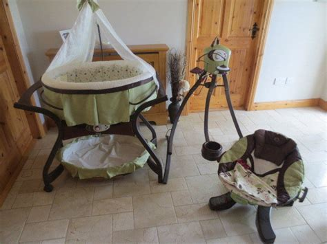 fisher price zen swing fisher price zen cradle swing and sliding bassinet for