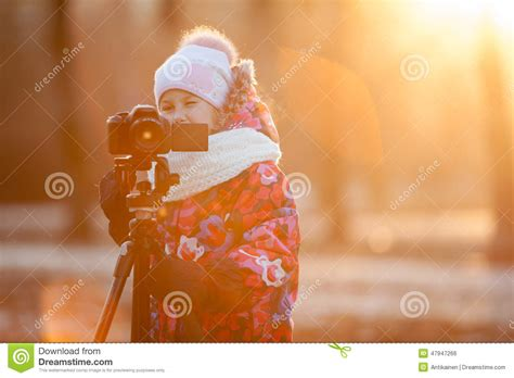 taking a stock of space lighting and design in your young child photographer taking pictures on camera using