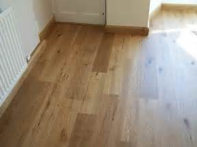 planning ideas real wood vs laminate floors which