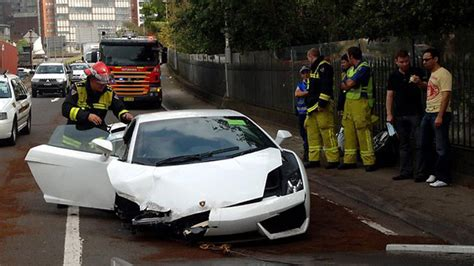 crashed white lamborghini man crashes lamborghini gallardo on test drive