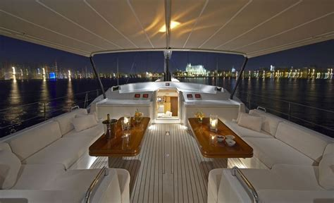 rent a boat for a night sailing yacht nephele deck seating and bimini at night