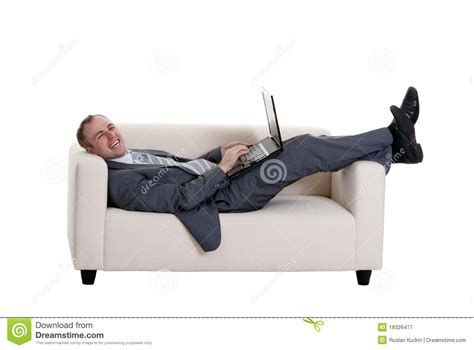 lying on a sofa businessman lying on the couch royalty free stock