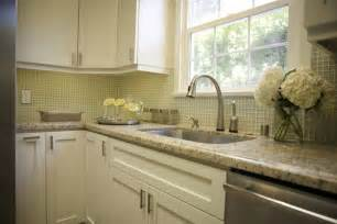 White kitchen cabinets with green granite countertops