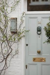 pale green front door gray front door transitional home exterior berry