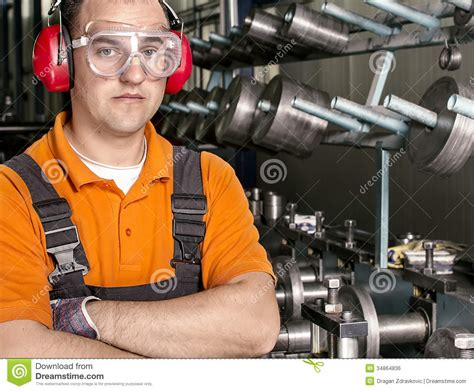 Production Worker by Worker With Antiphons And Protection Glasses In Front Of Production Machine Royalty Free Stock