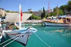 boten duden huizen op de rots in kekova turkije stock afbeelding