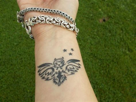 owl arm tattoos 35 awesome owl wrist tattoos design