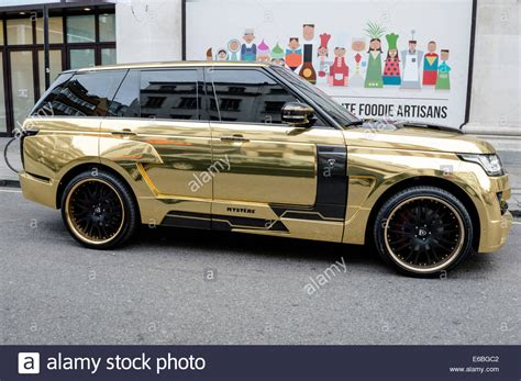 gold range rover saudi gold range rover parked outside of selfridges