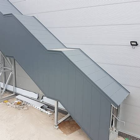 guttercrest fascia cladding encapsulates fire escape