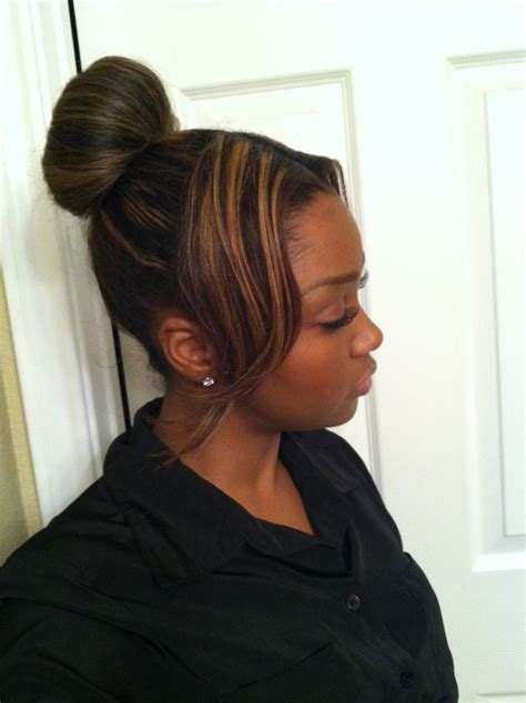 high bun with swoop bang timeless fashionable hair idea for the woman on the go