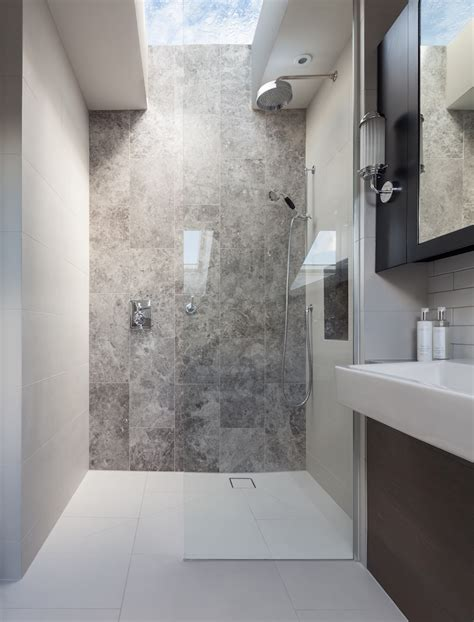 bathroom roof lights peek architecture design walk in shower stone feature wall silver emperador