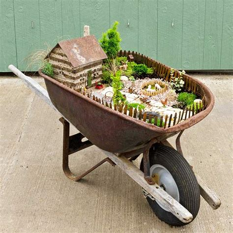 Wheelbarrow Planter Ideas by Plant Up A Wheelbarrow Garden