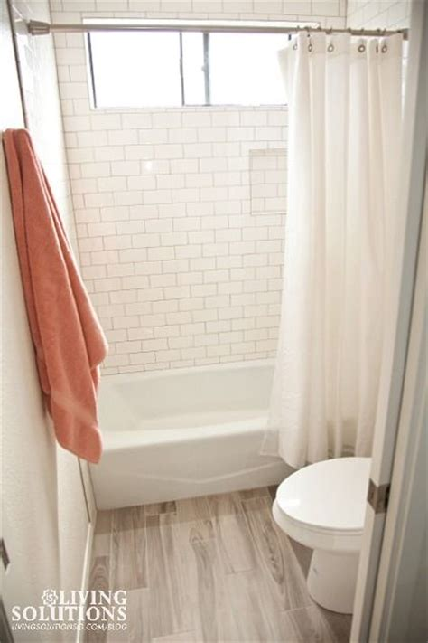 bathroom flooring solutions wood plank tile floor and white subway tile with gray grout bath living solutions interior