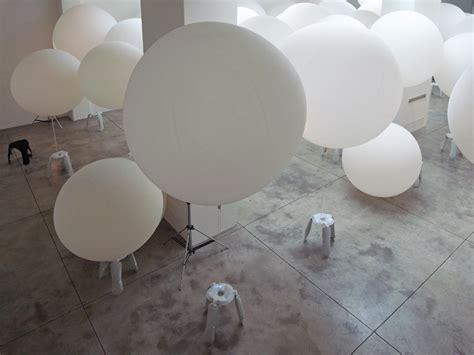 designboom installation oskar zieta bazair installation with aluminium plopp stools